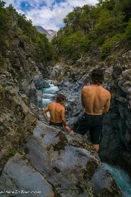 Mark Taylor and Aeon Russo looking into La Cocina, rio claro chile patagonia two shirtless dudes black rock basalt scenery whereisbaer.com Chris Baer