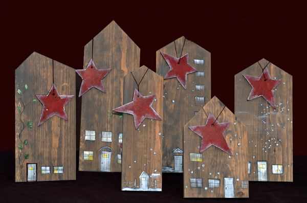 red Christmas stars on wooden house shapes