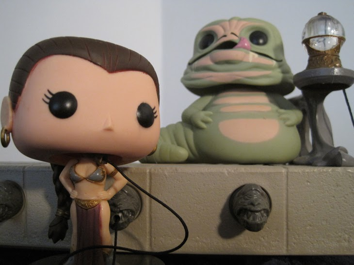 Funko Pop! Star Wars Slave Leia and Jabba the Hutt posed with a vintage SW: Return of the Jedi playset.