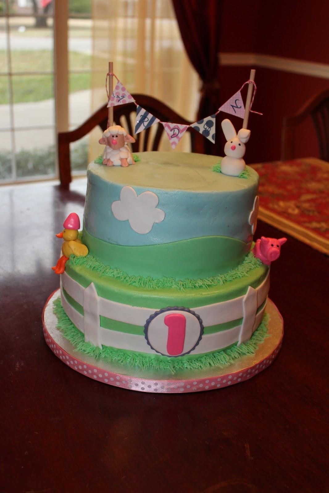 A Blissful Bash Baby farm animal first birthday cake