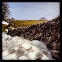 Snow on stone walls