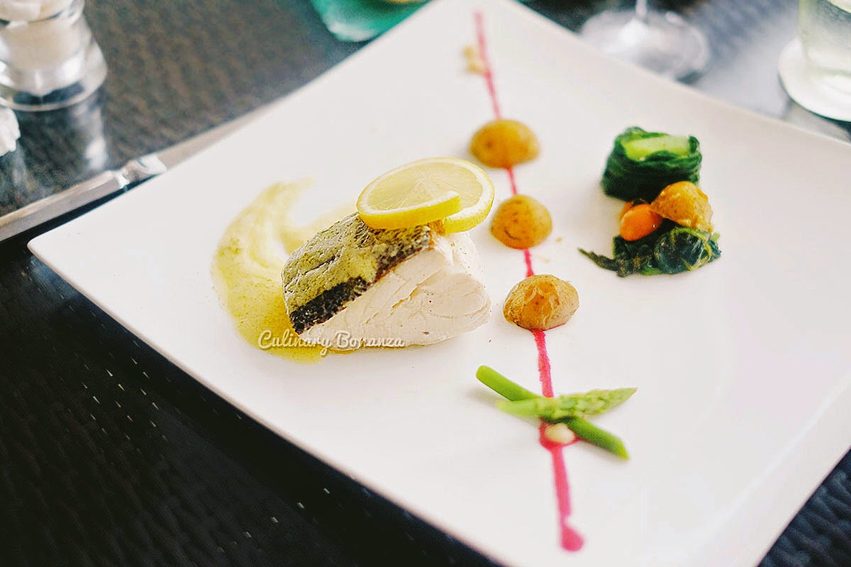 Main Course: Poached Cod Fish - served with roasted baby potatoes, spinach, cherry tomatoes, asparagus & low-fat citrus beurre blanc sauce (www.culinarybonanza.com)