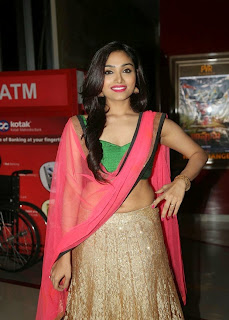 Aishya Devan in Lovely Green Choli and Golden Ghagra with Red Pallu at Anekudu Movie Audio Launch