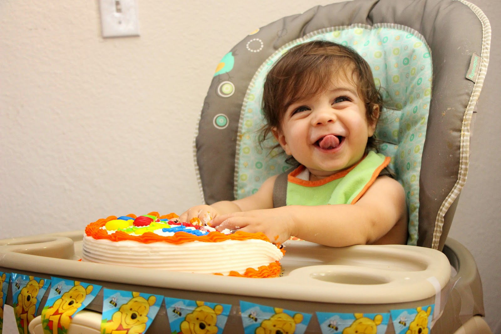 My son enjoying his 1st birthday cake