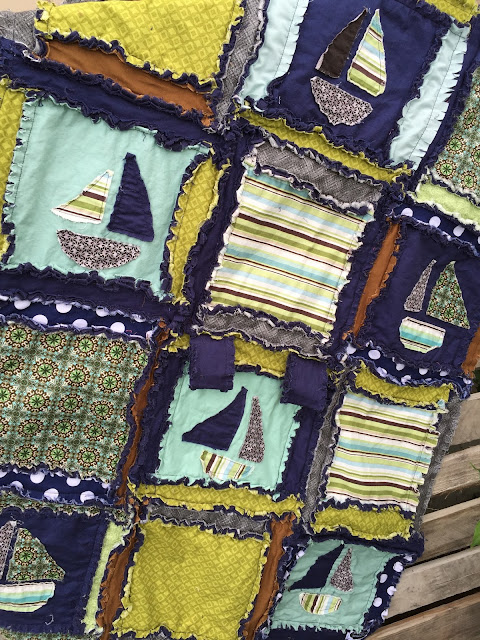 Close up of applique Sailboats on Rag Quilt