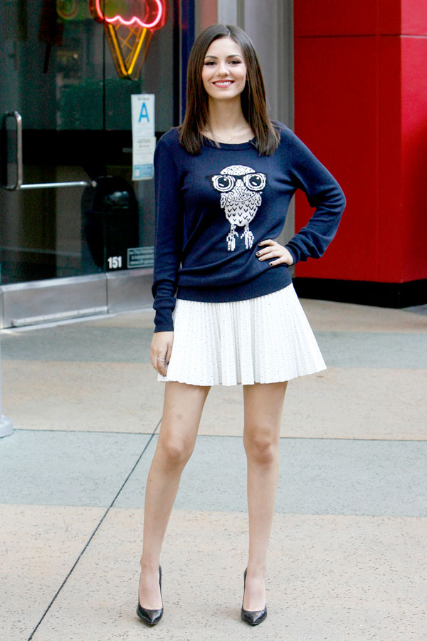 Victoria Justice in an owl print sweater and white mini skirt on the set of Extra in California