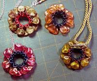 Several Petals, petals, petals pendant/brooches.