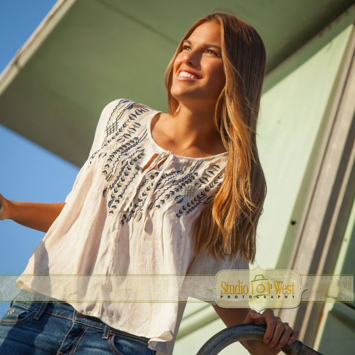 senior portrait on lifegard tower - senior pictures - Atascadero - Studio 101 West Photography