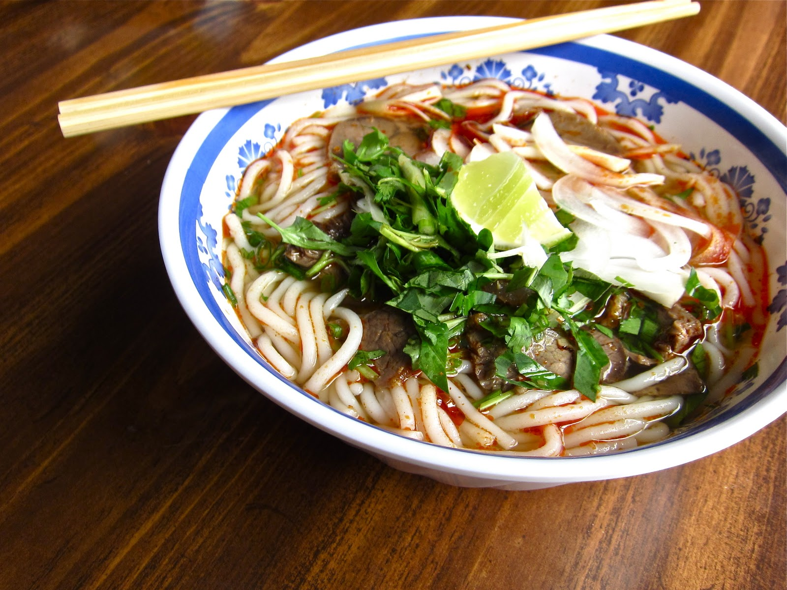 Titillating Delights: Bun Bo Hue (Beef and lemongrass noodle soup)