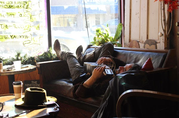 guitar player sleeping in a coffee house