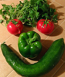Smiley Face Made of Tomatoes, Bell Pepper, and Cucumber, with Cilantro for Hair