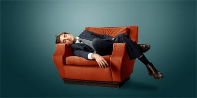 How to Get Over Excessive Sleeping  - man wear suit sleep on chair