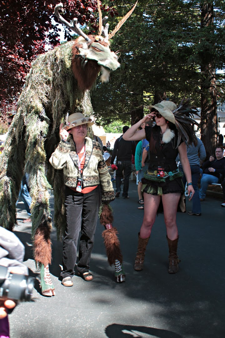Attendee poses with ancient forest spirit and wood pixie