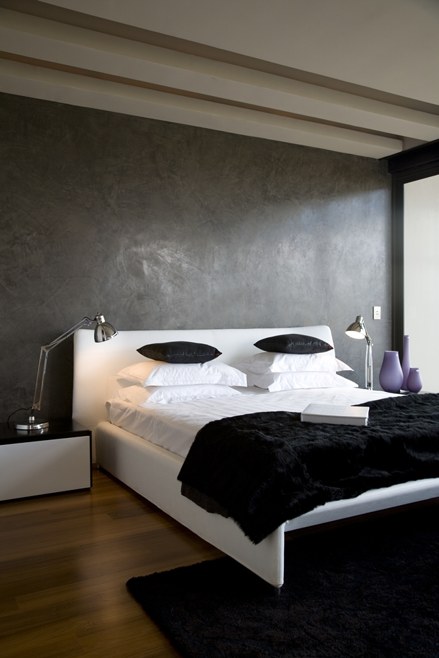 White modern bed in the Serengeti House by Nico van der Meulen Architects