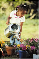 NAMC montessori preschool student introducing gardening girl watering plants