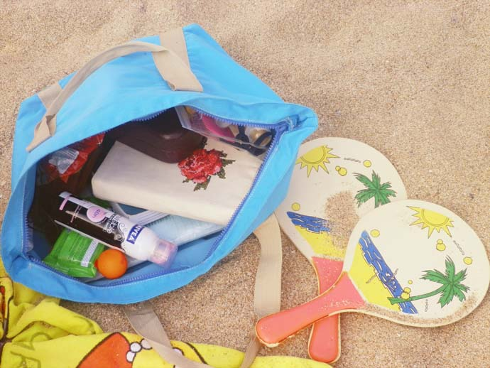 My beach bag with everything in it in the sand in Sozopol, Bulgaria