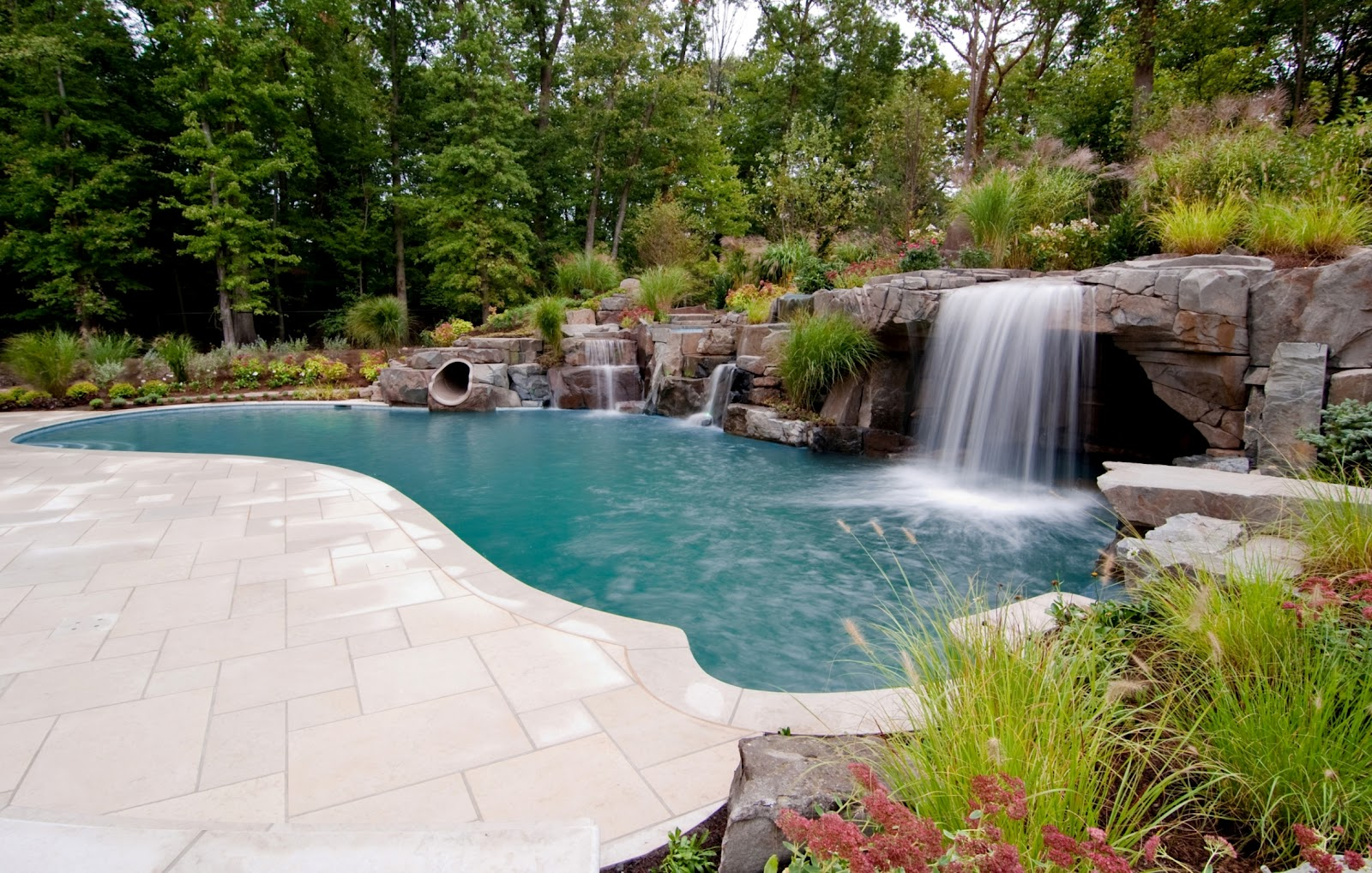 Pin by allyson james on amazing pools hot tubs pinterest for Beautiful swimming pools with waterfalls