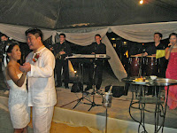 The wedding couple having their wedding dance accompanied by the band