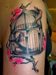 Bird cage and flying bird tattoo