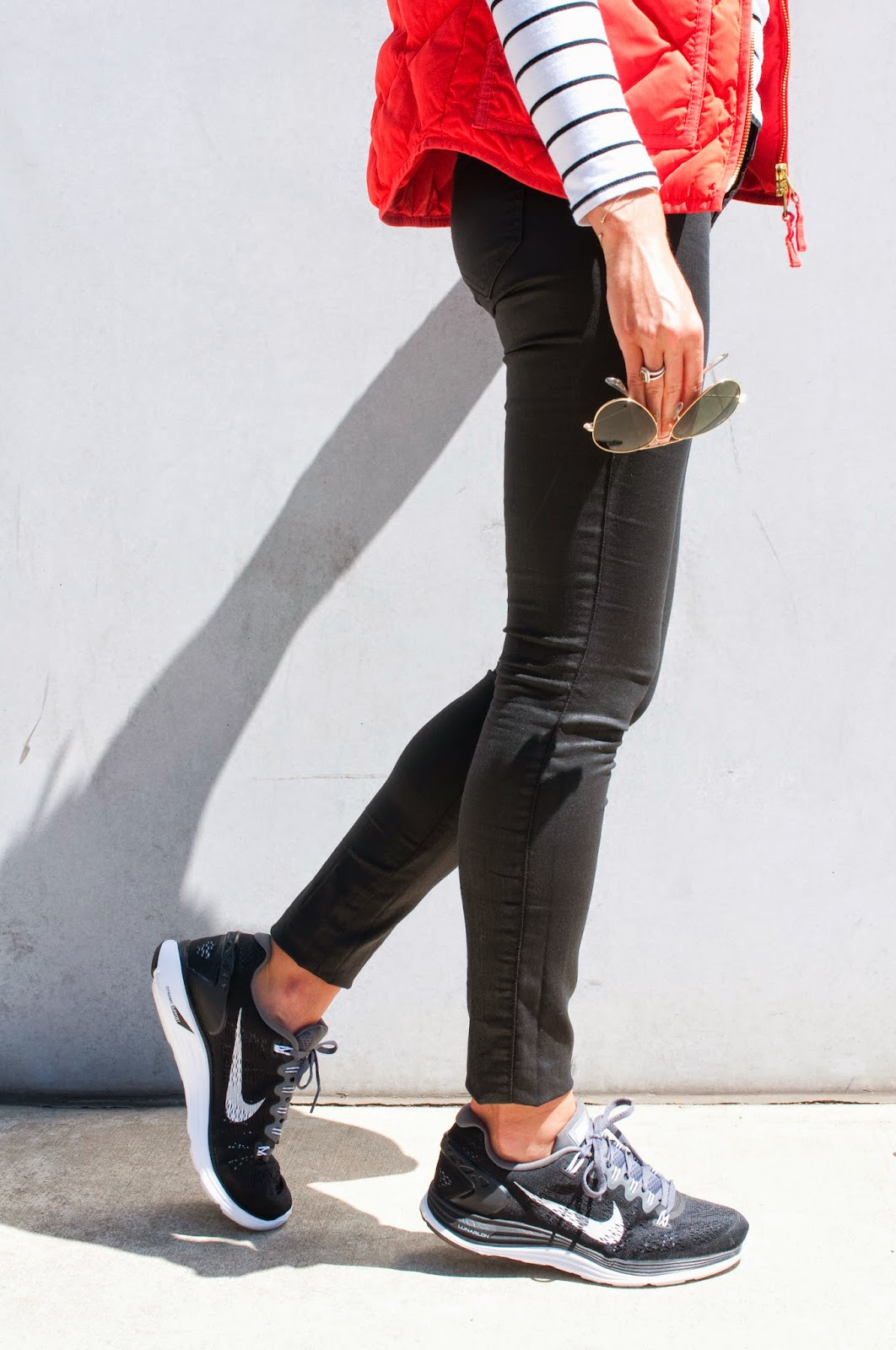 black-nike-sneakers-paired-with-coated-jeans