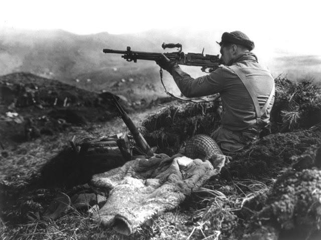A Canadian soldier inspecting a captured Japanese Type 96 machine gun, Kiska, Aleutian Islands, US Territory of Alaska, 16 Aug 1943