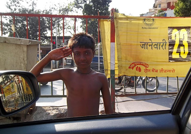 poor child at traffic signal