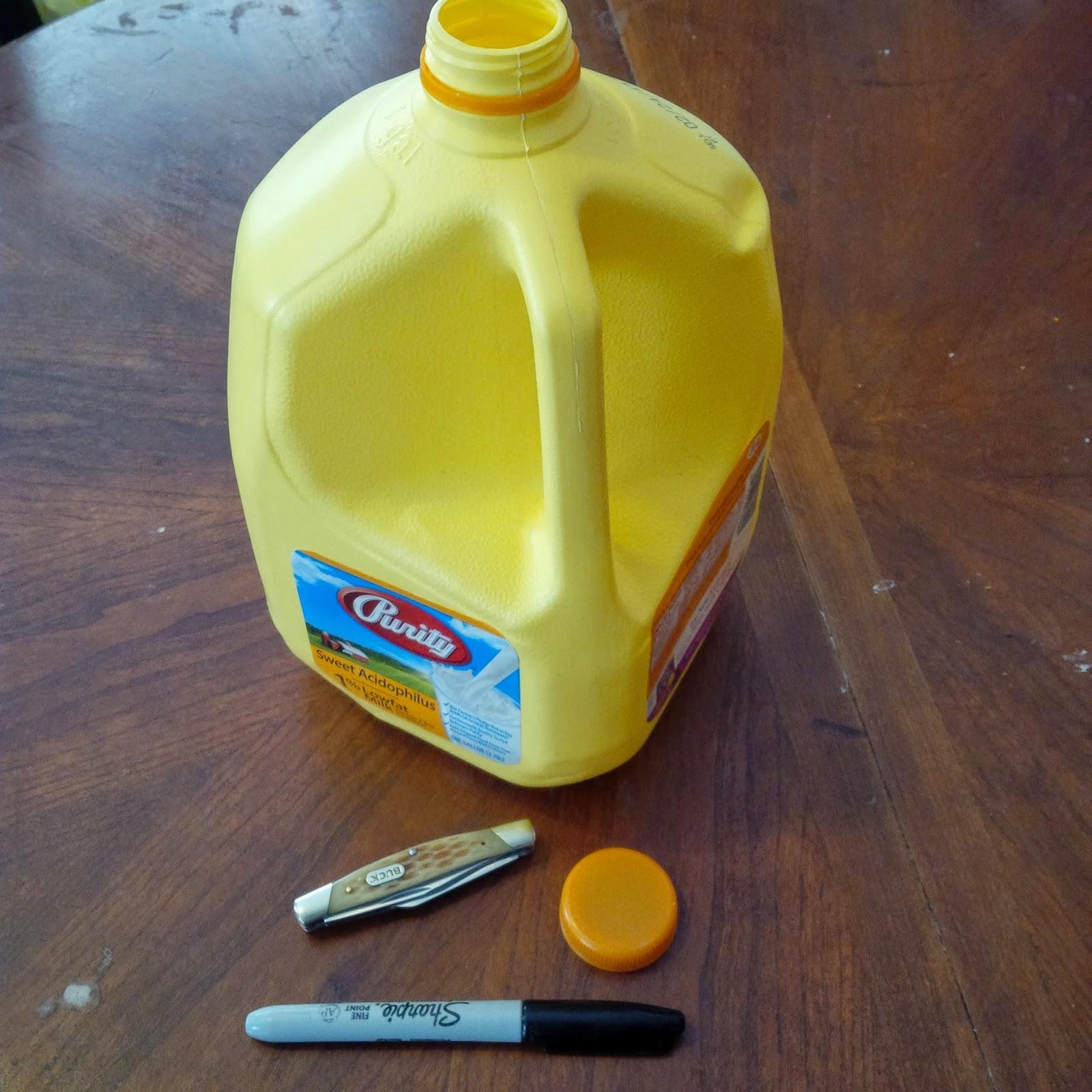 milk jug, marker, milk jug lid, knife