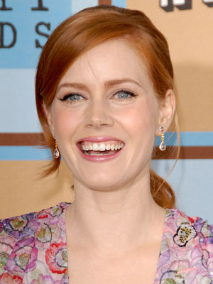 Amy Adams' straight strands are swept back into an elegant, low ponytail.
