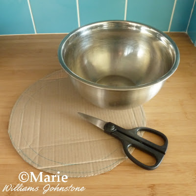 Thick card, scissors and metal bowl to draw around