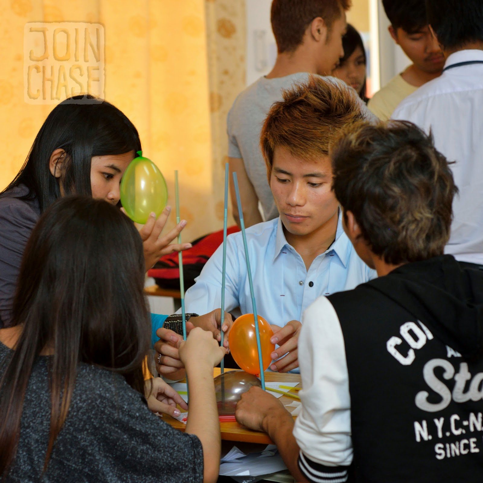 Students building balloon towers during English class in Yangon, Myanmar.