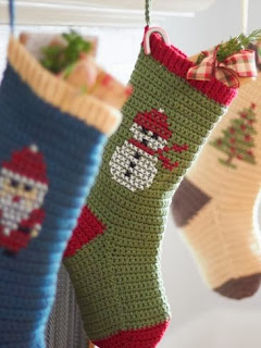 http://www.yarnspirations.com/pattern/crochet/cross-stitch-christmas-stockings
