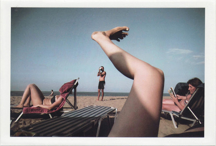 dirty photos - on the island of - street photo of leg and people at the beach