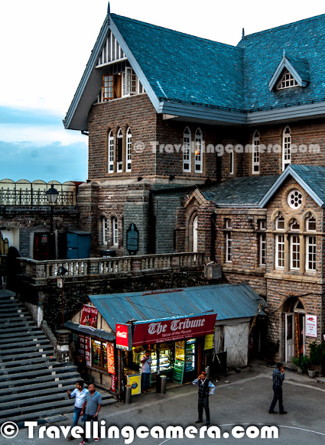 While coming back from Kinnaur, I spent two days in Shimla. While roaming on the Mall Road, we happen to visit a Cafe called 'Wake & Bake' and really loved being there during evening. This Photo Journey shares some of the moments I spent at Wake & Bake, Shimla. So here is the first view you get from the Cafe Windows. Wake & Bake Cafe is on 2nd floor of the building just in front of Shimla Town Hall on Mall Road, Shimla. It has decent place to sit on 2nd floor as well as open air terrace with a great view of the deep valley on other side.Here is the view we get from open air terrace of Wake & Bake Cafe. This view is something that you may get from other restaurants or cafes as well, but the one towards Mall road is special for me. Above view showsn two huge huge buildings - High Court of Himachal Pradesh and Holiday Home Hotel by HPTDC. Colorful view during evening was really amazing. Cafe has some vibrant colors with colorful lighting on Town Hall Building on the front & the blue sky in the background. Here is an amazing art-work on the walls of Wake & Bake Cafe. During daytime, this wall looks normal (but of-course, interesting artwork ) but in evenings all these colors pop-out to give a 3D view. It's really awesome and shiny colors make this art perfect. We also got to know the view of artist who created this wonderful piece of art on walls on Wake & Bake cafe on Mall Road, Shimla. Closer look at the wall. I loved this portion of the wall. This was looking awesome from distance. Because of good number of people at cafe, I couldn't click it from right place. Never mind, will try to get better shot next time :)I am sure that above photograph will give you a perspective about the place. This is clicked from main counter of the Cafe. As we enter into the cafe, this is first view we get. An open window facing Shimla Town Hall building and wonderful artwork on the right wall. I have nothing to share about eatable at Wake & Bake, as I don't remember what I had there. I was so busy in appreciating in beauty around that I didn't bother to focus on eatables or drinks there. But I am sure that it must be great as the place iAneesh keeping an eye on seating place around roof top of the Cafe..Here is the view of Shimla Town Hall on Mall Road.. This is shot from entry of the Wake & Bake Cafe.. There is a series of stairs that lead to the cafe on second floor.A view of street where Wake and Bake Cafe is located. The blue board on one of the building on left is exactly the place and yellow windows behind that belongs to Wake & Bake Cafe. On the right side is Shimla Town Hall on Mall Road in Shimla.Here is another view from windows of Wake & Bake Cafe. This Gaiety Theatre complex and this particular portion is used but Police. I love architecture of these buildings.If you are around Shimla and roaming around mall road, I highly recommend this place to spend some time. And if you happen to visit, please drop your comments with experiences.