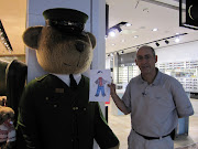 . picture in front of a Harrod's store character at the London Airport. (img )