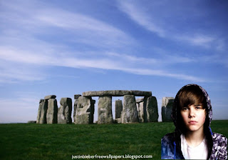 Desktop Wallpaper of Justin Bieber singer sad face in hood at Stonehenge Stone Monument Desktop wallpaper