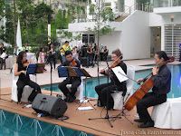 String Quartet performing by the poolside
