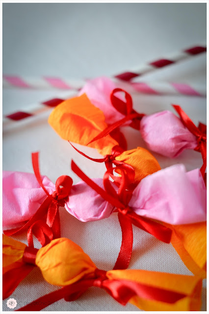 Candy wrapped with paper and bows idea for a sweet party from BistrotChic