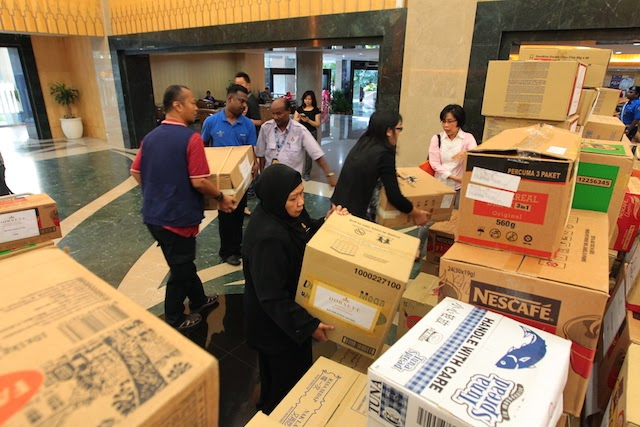 All packed and ready to be delivered : Associates from Dorsett Hospitality International's hotels and officers from Kuala Lumpur City Hall were busy transporting more than 400 cartons of boxes to Kuala Lumpur City Hall's Humanitarian Aid for Flood Victims Collection Centre.