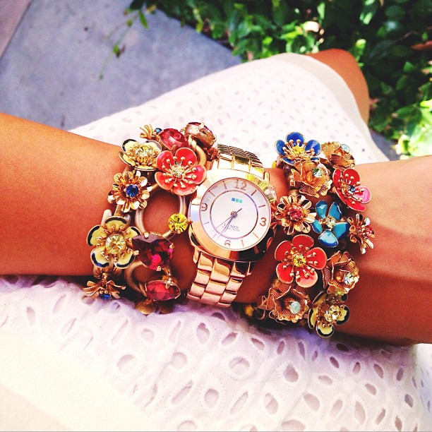 Stephanie Liu of Honey & Silk wearing Chloe and Isabel floral jewelry and La Mer Odyssey watch