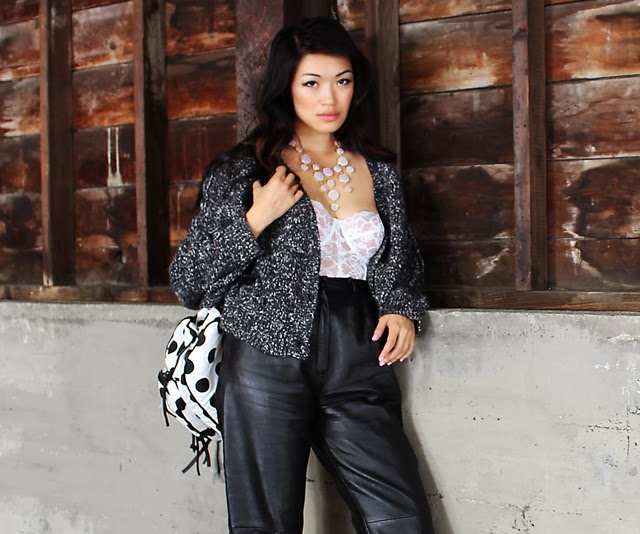 Vancouver fashion blogger Jasmine Zhu wearing vintage leather pants and lace bustier aritzia cardigan necessary clothing necklace and shoes and polka dot backpack