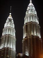 Urban spires lit up at night