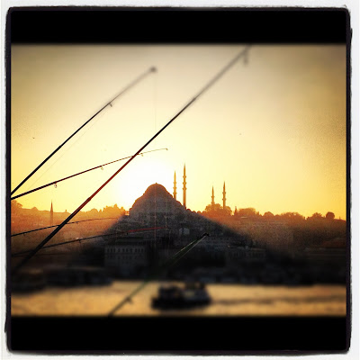 A view of the mosque from the Galata Bridge for tourists in Istanbul