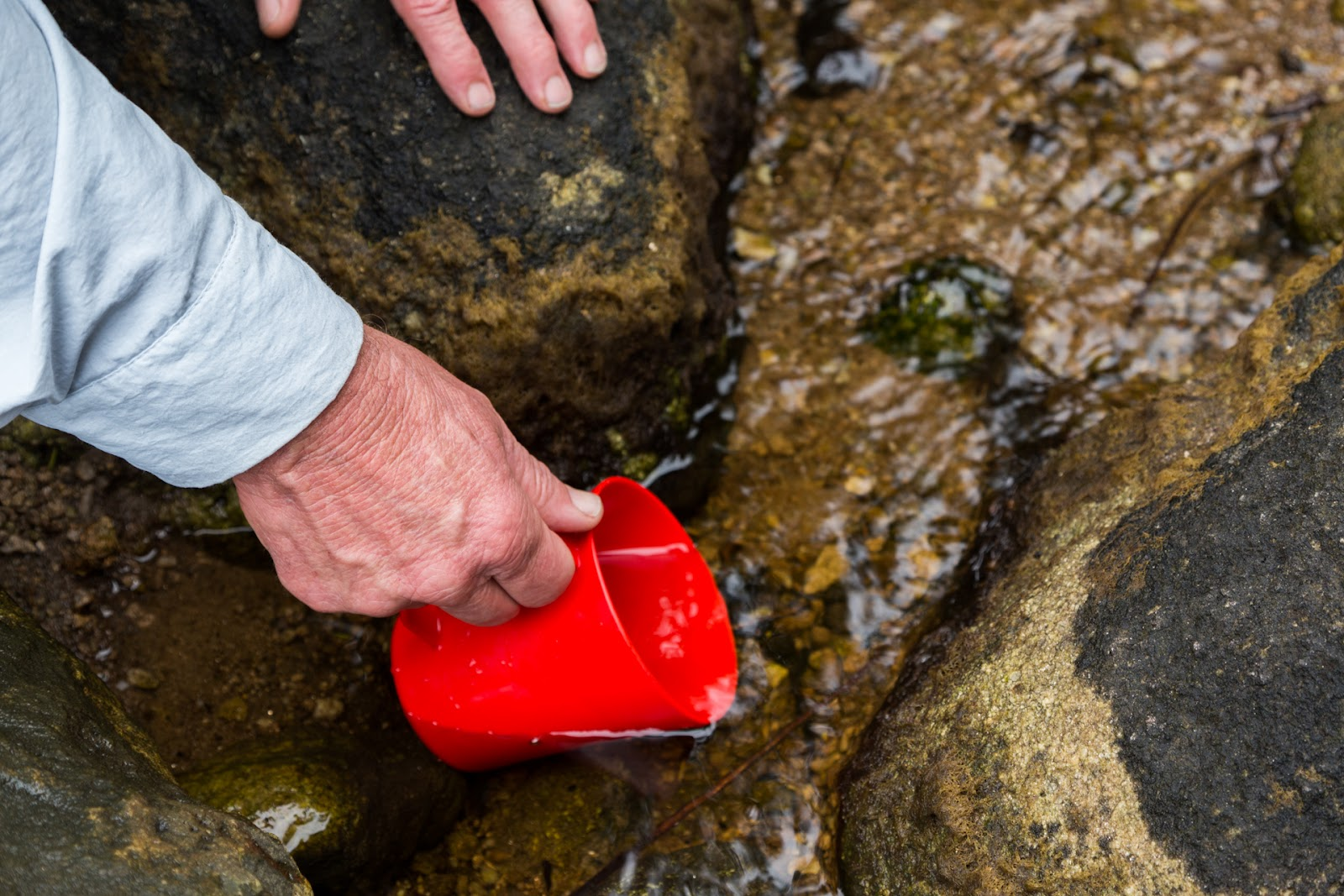 filling cup with water wilsons promontory