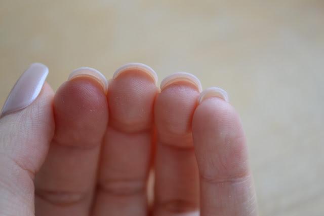 The gap under the imPRESS Press-on Manicure false nails