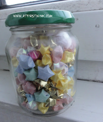 Folded stars in a glass jar