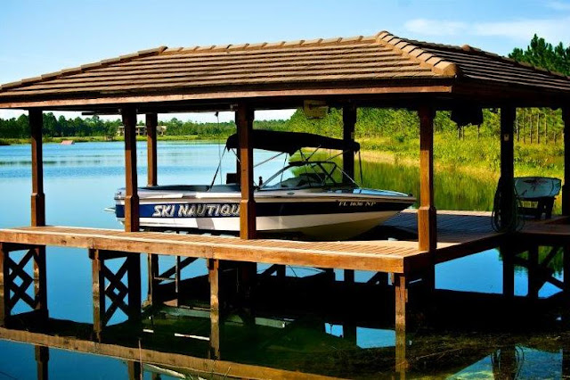 Picture of the boat parked in garage on the lake