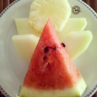 Anjinho com frutas