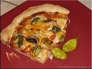 homemade pizza with pickled peperoncini peppers