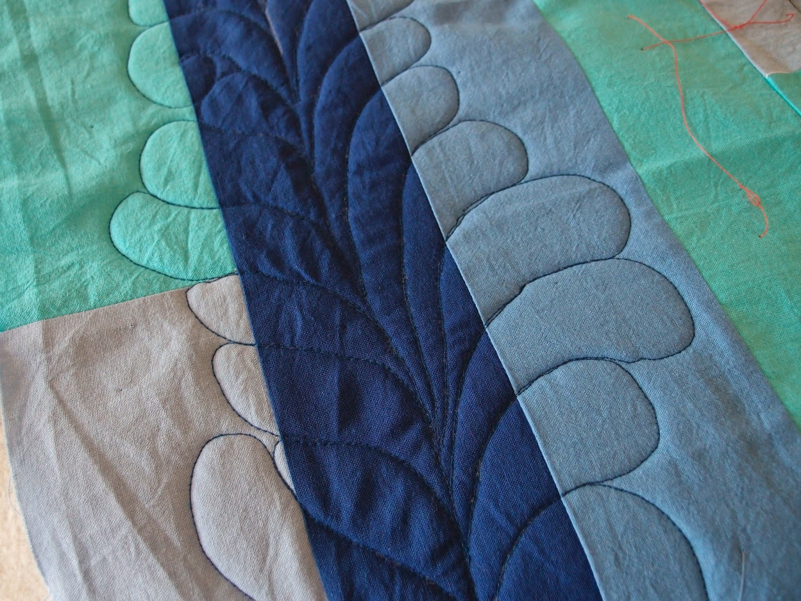 blue quilt feather quilting - close up