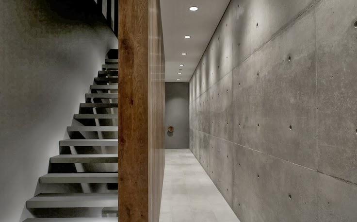 stairs with concrete wall